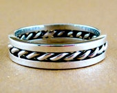 Sterling silver men's band with a twist