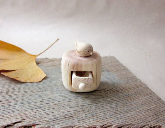Miniature cabinet with a cute little bird, wood carving