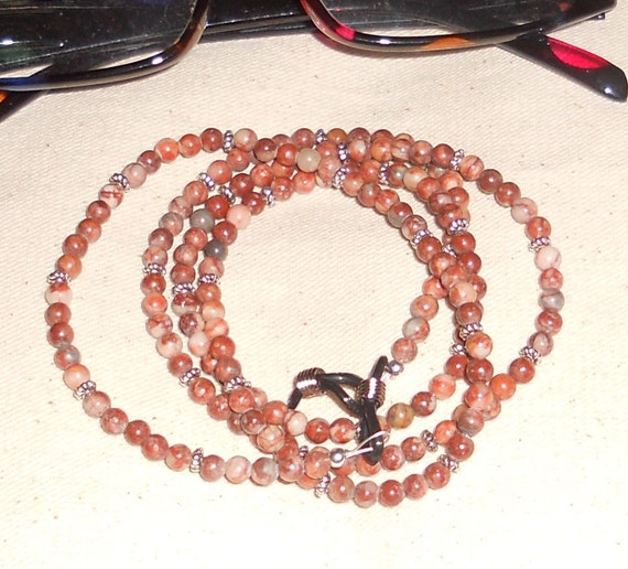 Red and white jasper eyeglass chain packaged in a colorful gift bag I1131