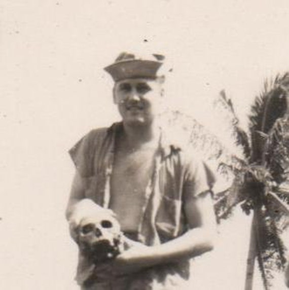 Vintage Photo Gruesome WWII Soldier Holding Human Skull 1940s War Atcocities Snapshot