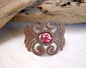 Acacia lace bracelet dark taupe with raspberry and ruby red swirl cabochon