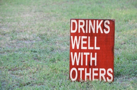 Drinks well with others sign made from reclaimed plywood