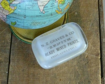 Antique Advertising Paperweight