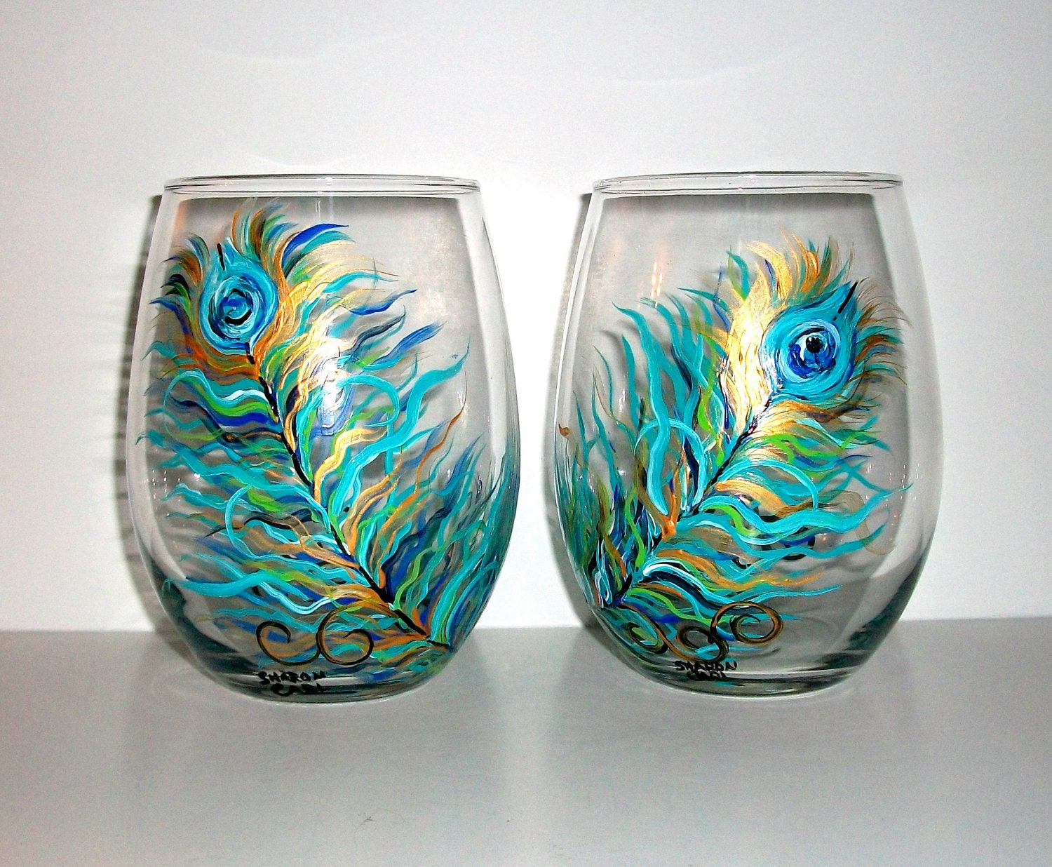 Peacock feathers hand painted stemless by sharonscustomartwork for Painted stemless wine glasses