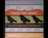 Happy Halloween colorful card with 3 glittered crows
