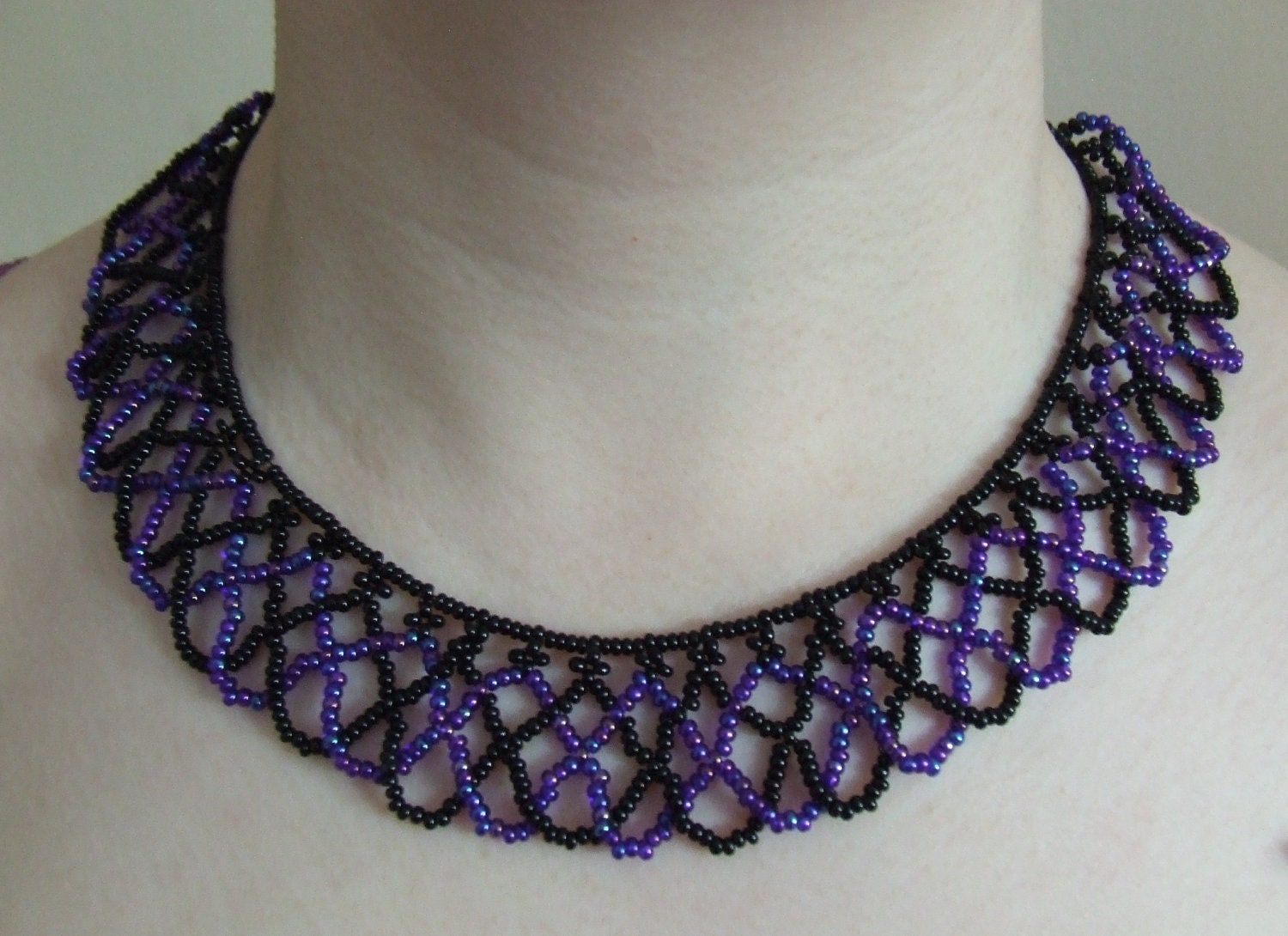 black peacock netted bead necklace by hazelscraftlore on
