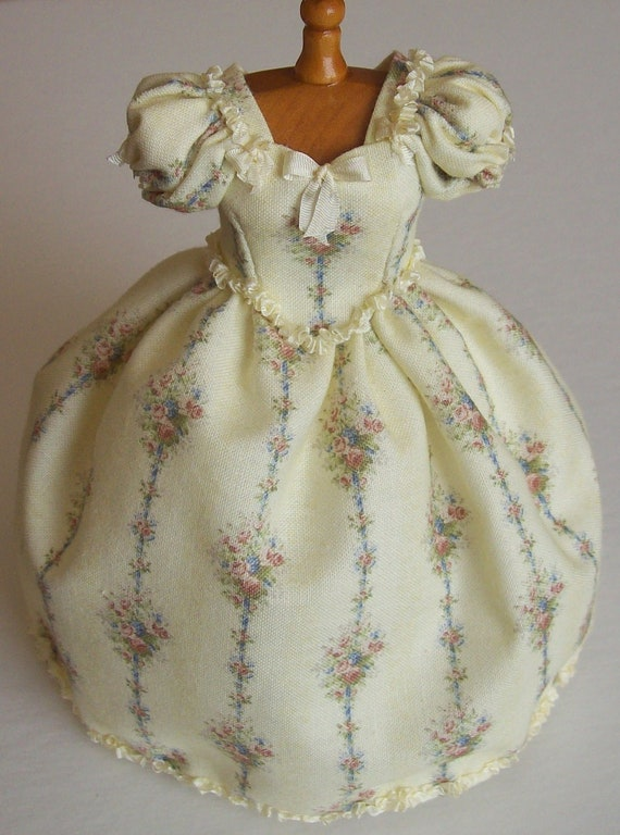 Ivory flower printed cotton day dress on mannequin handmade in 1/12th scale dollhouse miniature