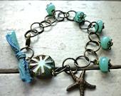 Starfish. Beach Bracelet. Tiffany blue Lampwork Spacer Beads. Dark brass chain. Czech picasso glass. Vintaj starfish charm. silk ribbon.
