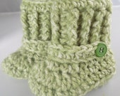 High top baby booties crocheted in heather green