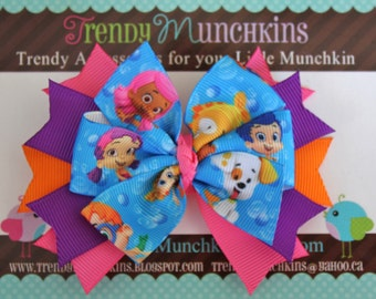 Bubble Guppies Pinwheel Hair Bow - Pink, Purple and Orange Spiked Bow