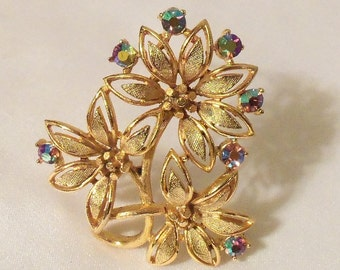 Vintage Lisner Brooch, Gold flowers Topaz Borealis Rhinestones, Signed, A mint condition 1960s vintage floral pin.
