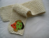 White knitted children's scarf with crocheted fish