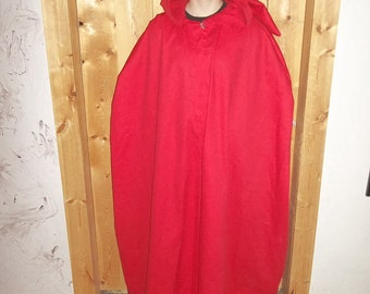 Red cotton twill weave cloak with silver filigree clasp.