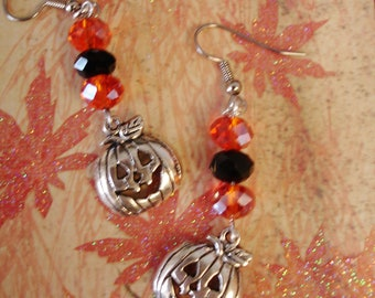 "Halloween, Autumn, Fall Pumpkin earrings  Orange and Black Crystals.  2 1/4"" long."