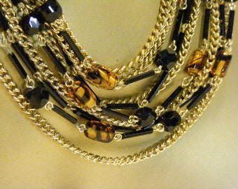 On Sale Multi Strand Bib Necklace in Black, Gold and Amber.  Perfect for Fall.