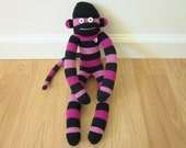 Striped sock monkey doll - black with purple and pink stripes with rhinestone heart