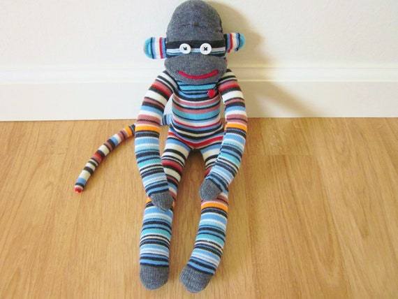 Earthy sock monkey with sky blue, brown, red, black, and white stripes - plush doll