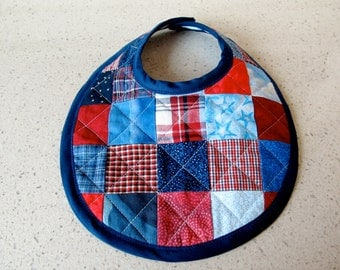 Red & blue checkerboard patchwork baby bib quilted on the diagonal