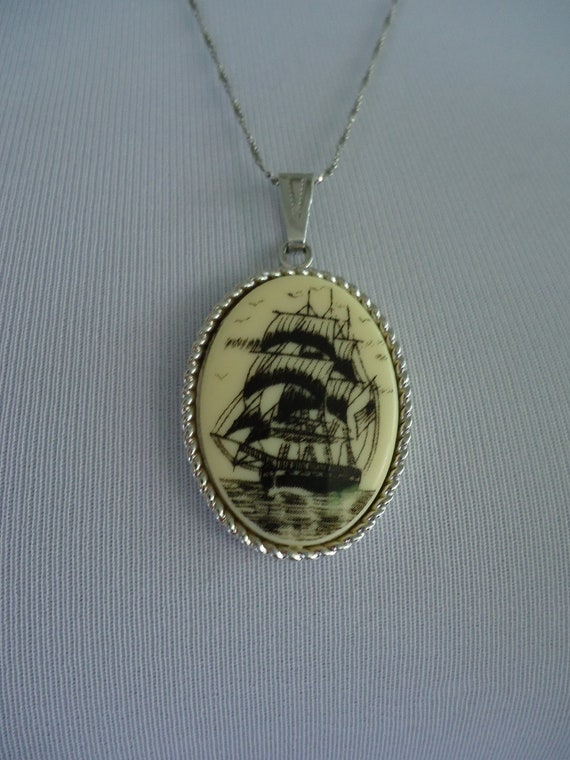 "1970s pendant / 70s Sarah Coventry Faux Scrimshaw ""Legend"" Sailing Ship pendant"