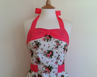 Retro apron with bow, coral peach floral on a cream fabric, fully lined.