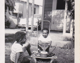 VTG B&W cute photo of two little boys-- one on a riding toy from 1958