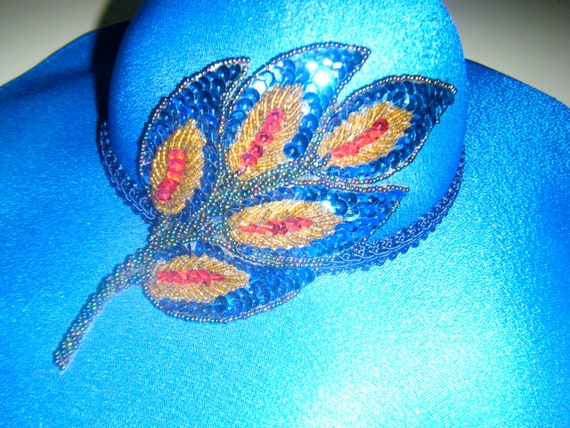 Avant garde 1960s  peacock sequined feather kentucky derby hat