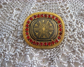 Large, lovely Damascene brooch with red rhinestones