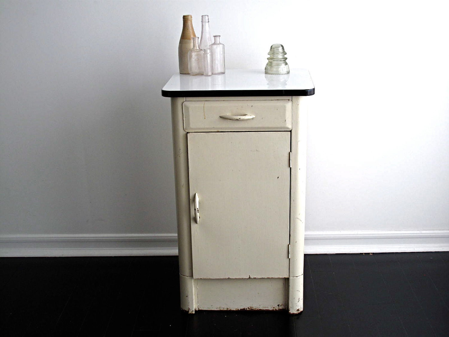 vintage white metal cabinet with an enamel top by snapshotvintage
