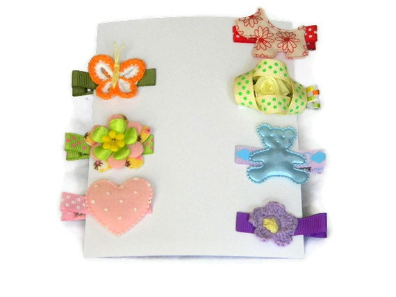 Girls Hair Clips Set of (7) in Red, Yellow, Green, Blue, Purple, and Pink on Lined Alligator Clips