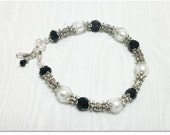 Silver foil lined bracelet with black and ornate silver spacers and earrings Sale