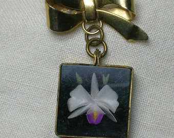 1950s Lucite Brooch with Pendant, Orchid in Black, Reverse Carved. Bow Dangle.