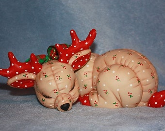 Handpainted Ceramic Christmas Reindeer painted with a Holly Berry print to look stuffed and a plaid ribbon