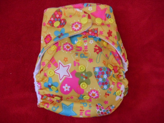 SassyCloth one size pocket diaper with lucky charms on yellow  PUL print. Made to order.