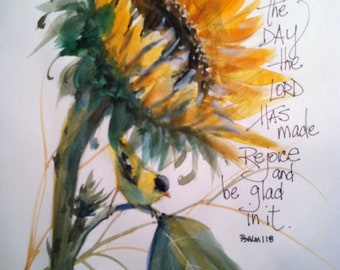 Watercolor of sunflower with goldfinch