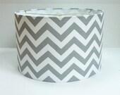 Medium Drum Lamp Shade in gray and white chevron / zigzag fabric.
