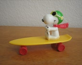 Vintage PEANUTS SNOOPY On Skateboard Toy  Hong Kong 1960's