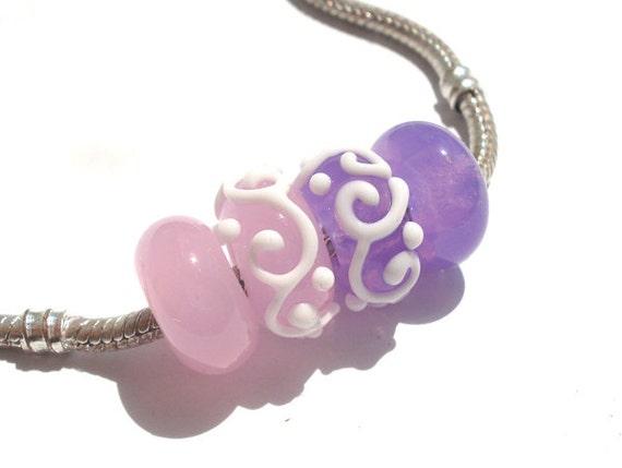 Set of 4 purple and pink  Glass  Handmade Lampwork Beads