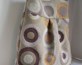Pleated shoulder bag in beautiful woven circles in purple mustard and eggplant