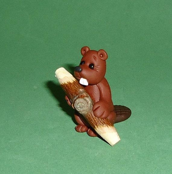 Polymer clay beaver holding log