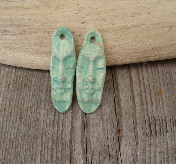 RESERVE listing for Andria Tribal Face pair of charms in matte teal   OOAK