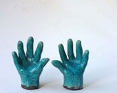 Ceramic Raku hands for rings or to frighten the wits out of your friends.