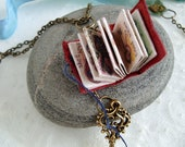 Red leather book necklace, 'Curious Keys', illustrated