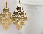 Matte gold earrings multiple circles light weight modern high fashion matte gold ear wire