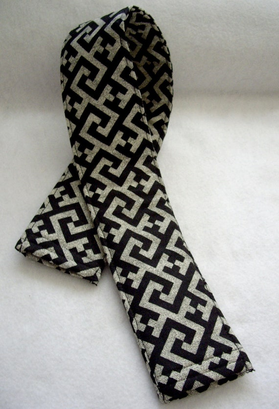 Camera Strap Cover for a Man or Woman with an Abstract Design and Lens Pockets