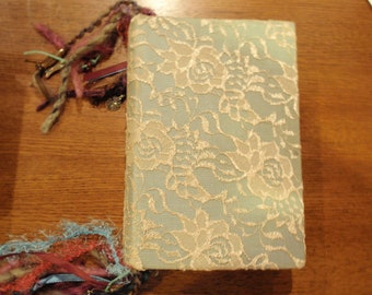 Lace covered altered book journal