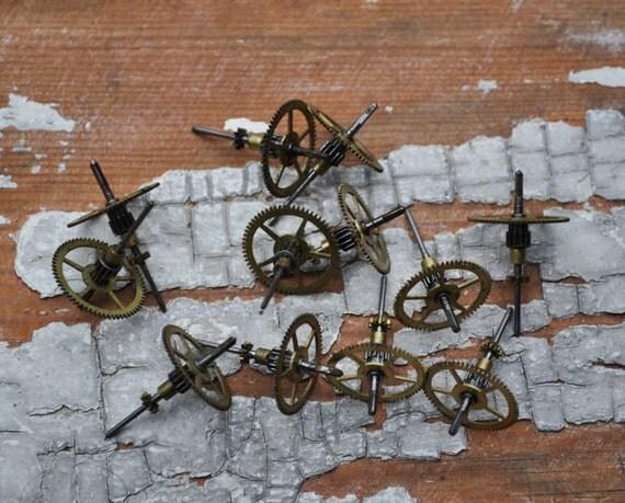 Set of 12 Vintage small brass clock gears,wheels,cogs.