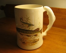Sandland Ware mug with northern pike swimming on each side and a fish handle