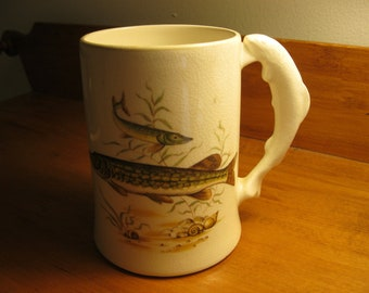 Sandland Ware mug with northern pike swimming on each side and a fish handle