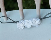 Three Small White Flowers on a Grey Elastic Headband for Newborn and Baby Girls