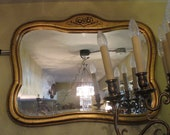 Mirror petite wooden frame with carving and golden patina beveled Europe from the 1960s